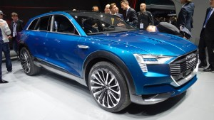 Crowds at the Frankfurt Auto Show admire the latest Audi electric SUV.