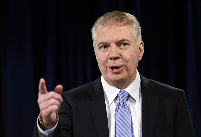 In this Oct. 9, 2013 photo, Sen. Ed Murray speaks during a debate in Seattle with Seattle Mayor Mike McGinn in their race for mayor. Seattle's mayoral hopefuls this year have been stumbling over each other as they try to appeal to the city's left-leaning voters, making promises that would be liabilities elsewhere but resonate in the eco-friendly city that's home to Starbucks and Amazon.com. Both unabashedly support substantial new taxes, a $15 minimum wage and legal marijuana. (AP Photo/Elaine Thompson)