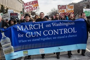 WASHINGTON, DC - JANUARY 26: Vincent Gray (C), Mayor of the District of Columbia, leads a march for stricter gun control laws on January 26, 2013 in Washington, DC. The demonstrators included survivors of the shooting at Virginia Tech, Newtown, Connecticut, and others. (Photo by Brendan Hoffman/Getty Images)