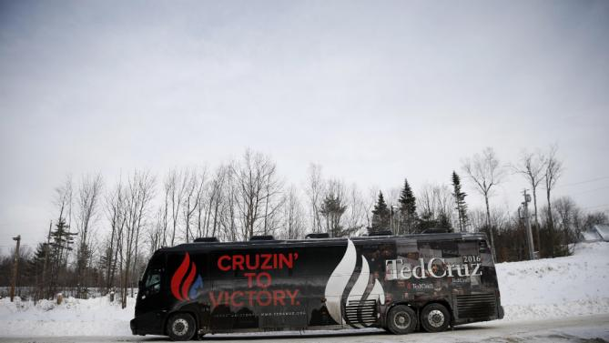 Republican presidential candidate, Sen. Ted Cruz, R-Texas, departs on a bus from a campaign stop, Monday, Jan. 18, 2016, in Washington, N.H. (AP Photo/Matt Rourke)
