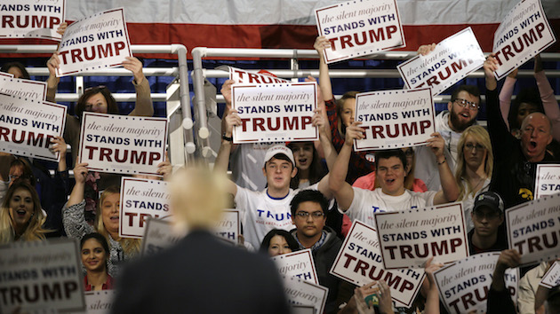 Supporters greet Republican presidential candidate Donald Trump during a campaign rally, Friday, Dec. 11, 2015, in Des Moines, Iowa. (AP Photo/Charlie Neibergall)