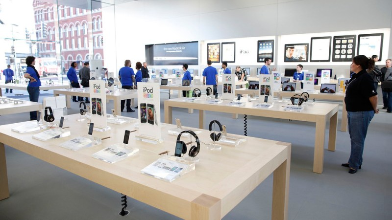 CHICAGO - OCTOBER 21:  Apple emloyees and media wander the new Apple Store during a media preview on October 21, 2010 in Chicago, Illinois. The new store opens on October 23 in Lincoln Park, a part of the city's Near North Side that has been trendy for several years.  (Photo by Brian Kersey/Getty Images)