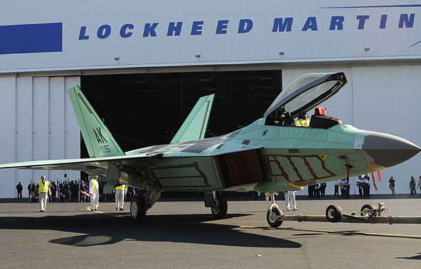 The final F-22 Raptor fighter jet rolls out of the assembly plant during a ceremony marking the occasion at the Lockheed Martin Plant in Marietta , Georgia, in this December 13, 2011, file photo.  Lockheed Martin Corp, the largest U.S. weapons maker, on October 24, 2012,  posted an 11 percent increase in third-quarter earnings, beating expectations by a wide margin, and raised its full-year forecast. REUTERS/Tami Chappell/Files (UNITED STATES - Tags: MILITARY TRANSPORT BUSINESS)