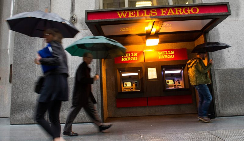 Pedestrians walk in front of Wells Fargo & Co. headquarters in San Francisco, California, U.S., on Wednesday, March 14, 2012. Wells Fargo & Co. joined U.S. banks raising dividends and authorizing share repurchases after passing the Federal Reserve's test of how lenders would fare in an economic decline. Photographer: David Paul Morris/Bloomberg via Getty Images