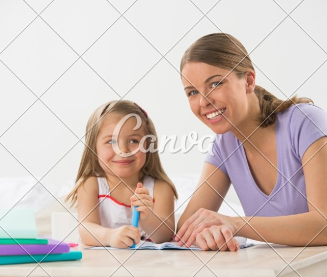 Mom Teaches Little Girl To Draw And Write