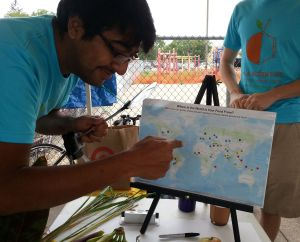 Mohamed Yakub, a plant evolutionary biologist, checks the map for the origin of his favorite foods.