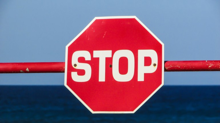 stop sign on gate
