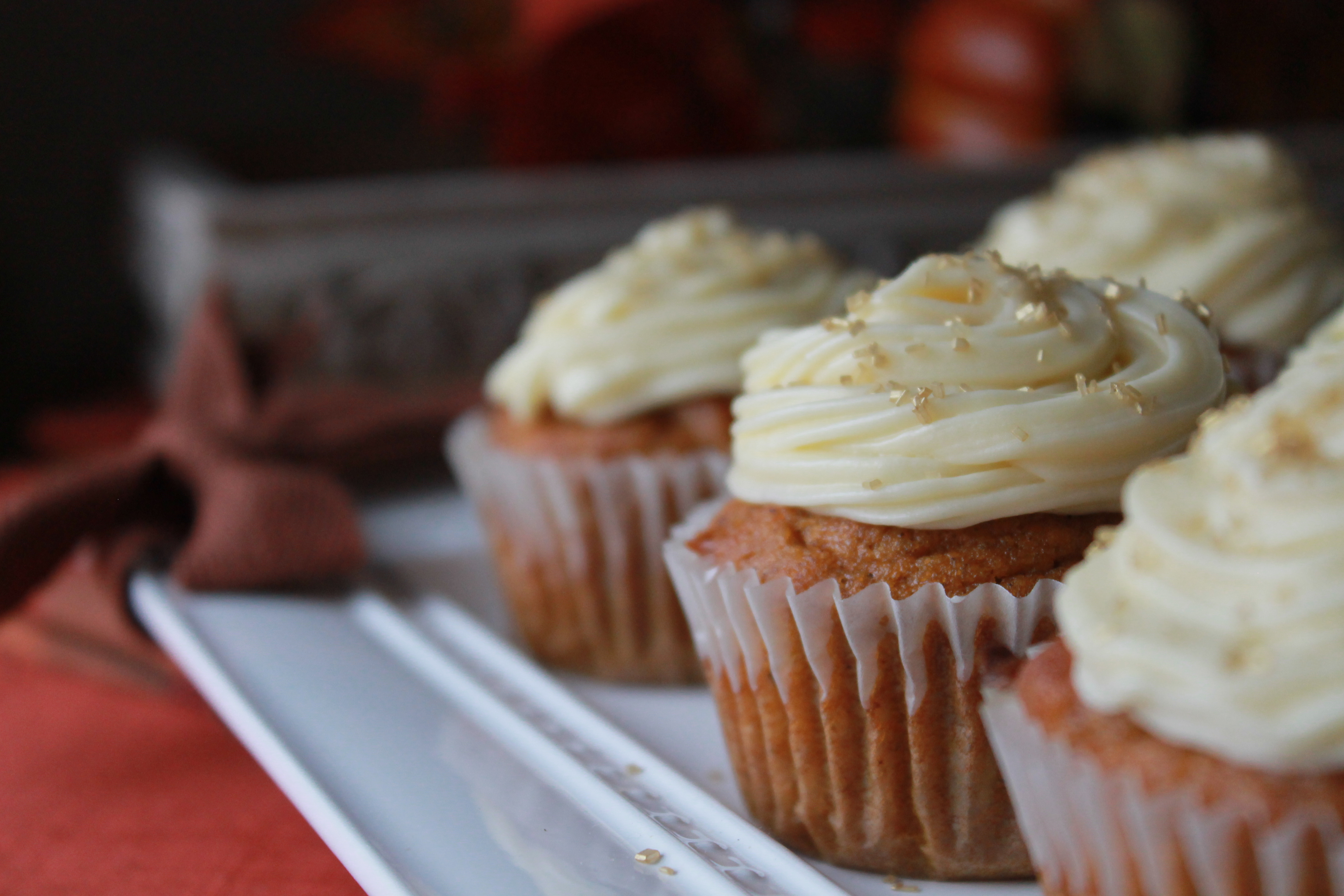 Pumpkin cupcakes with butter cream cheese frosting are the perfect Thanksgiving dessert