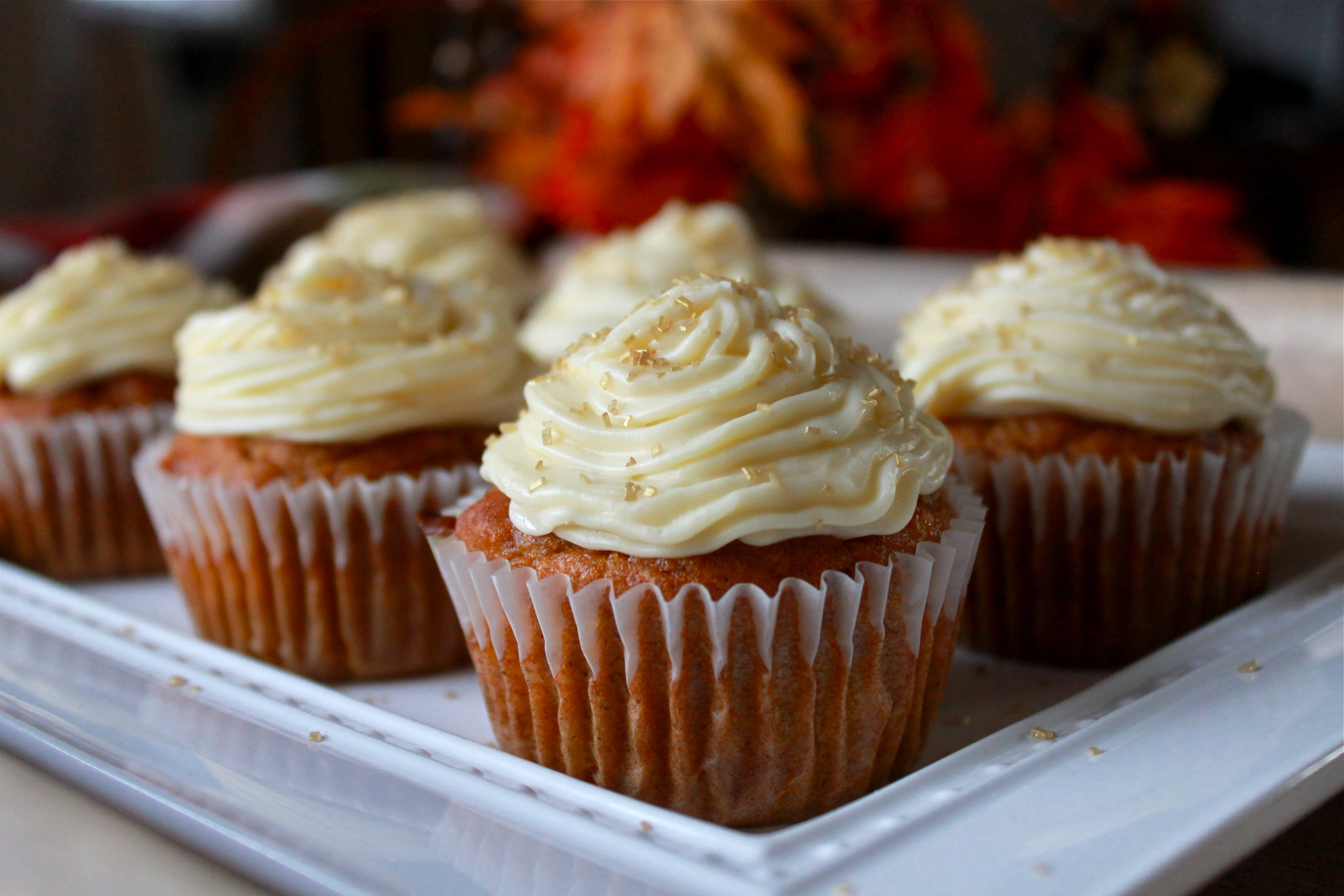 Pumpkin cupcakes with butter cream cheese frosting