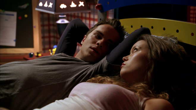 John Connor and Cameron lying in bed