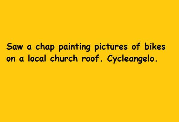 a chap painting pictures of bikes on a local church roof