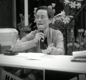 Picture of Theresa speaking at antiwar forum
