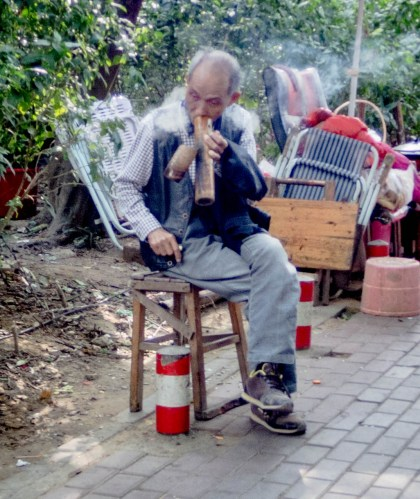 Man smoking huge pipe