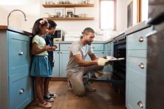 man teaching kids cooking skills