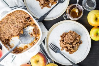 paleo grain free gluten free apple dump cake in a baking dish with a serving on a plate