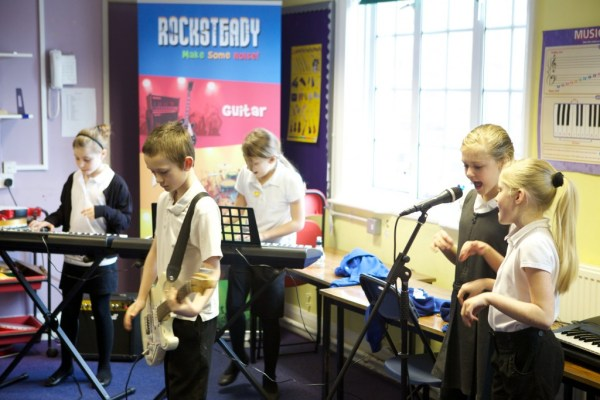 Children learning to play in their own band during the early days of Rocksteady Music School.