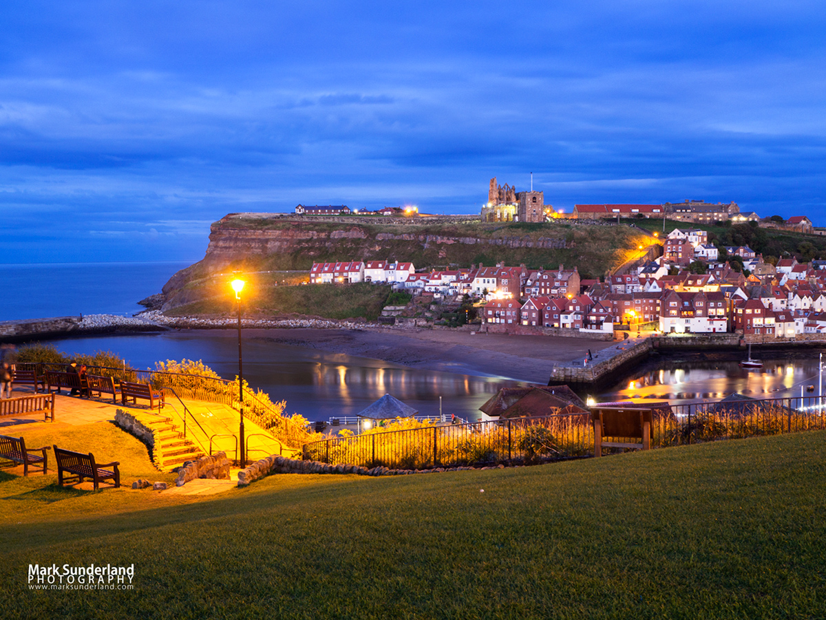 View from West Cliff to St Marys Church and Whitby Abbey at dusk, Whitby