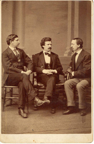 Photo taken in 1871 on a lobbying trip to Washington D.C. On the right is David Gray, editor of the Buffalo Courier. On the left is journalist George Alfred Townsend. Clemens was living and working in Buffalo at the time.