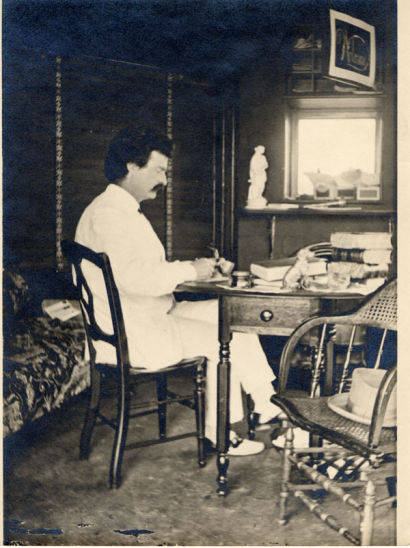 Samuel Clemens at work in his study at Quarry Farm, East Hill, Elmira N.Y.during the period in which he was at work on