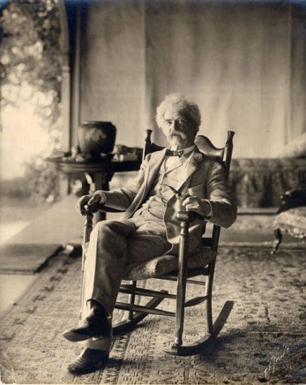 Samuel Clemens seated in a rocking chair on the porch at Quarry Farm, East Hill, Elmira New York.