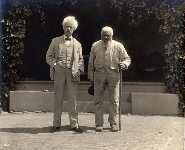 Samuel Clemens with John Lewis in the driveway at Quarry Farm, East Hill, Elmira, New York. John Lewis, a friend of the Clemens and Crane families was a pig farmer with land near Quarry Farm.