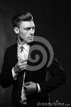 handsome-young-man-suit-dark-background-brunette-money-42910052