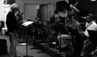 Tom Guralnick guest on bass sax w/ ORJO -- Outpost Repertory Jazz Orchestra -- rehearsal December 2, 1995 -- Jack Manno, conducting his arrangement; Michael Anthony, guitar; David Parlato, bass; Steve Figueroa, piano; saxes: Arlen Asher, Lee Taylor, Robbie Wilkerson, Bob Gusch -- photo by Mark Weber