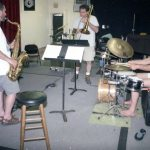 TG3 rehearsal June 17, 1996 at old Outpost -- Tom Guralnick, tenor saxophone; Steve Feld, trombone; Jefferson Voorhees, drums  --  ( Tom's Mobile Saxophone & Mute Unit is in the background) -- photo by Mark Weber