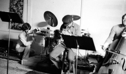 Jam session at Little Big Horn -- Sunday afternoon, possibly April 17, 1977 -- Bobby Bradford, cornet; Kevin Brandon, bass; and the great drummer-percussionist Kim Calkins from Venice Beach who Glenn Ferris brought into the Bradford fold for awhile, I just loved Kim's playing, and then circa 1979 he committed suicide ( I don't know why) -- NOTE my (MW) Pollock-esque abstract painting on the wall -- photo by Mark Weber
