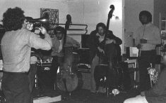 Sunday afternoon jam session at The Little Big Horn -- November 28, 1976 -- Glenn Ferris, trombone (his back to camera); Bobby Bradford, cornet; Roberto Miranda & Richard Rehwald, basses; Vinny Golia, bass clarinet; James Newton, flute; John Carter soprano sax & clarinet -- photo by Mark Weber
