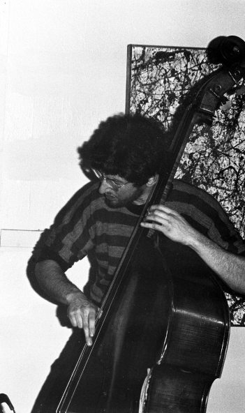 Mark Dresser at Little Big Horn -- January 1977 -- photo by Mark Weber (note my abstract painting on the wall when I was going through my Pollock Phase (in high school)(those paintings were several years old by the time they found a home at LBH))