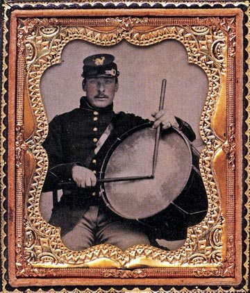 When I'm doing a photo sitting or portraiture I sometimes bring along examples of old photos I would like to approximate -- the photo of TG3 in this exhibit is an example of that approach -- I love those 1920s jazz band publicity stills -- This one of a Civil War drummer was in a recent issue of The New Yorker and I showed it to Cal and so we re-imagined this shot one afternoon in Santa Fe (May 20, 2o13) -- Cal added the gilded frame -- photo by Mark Weber