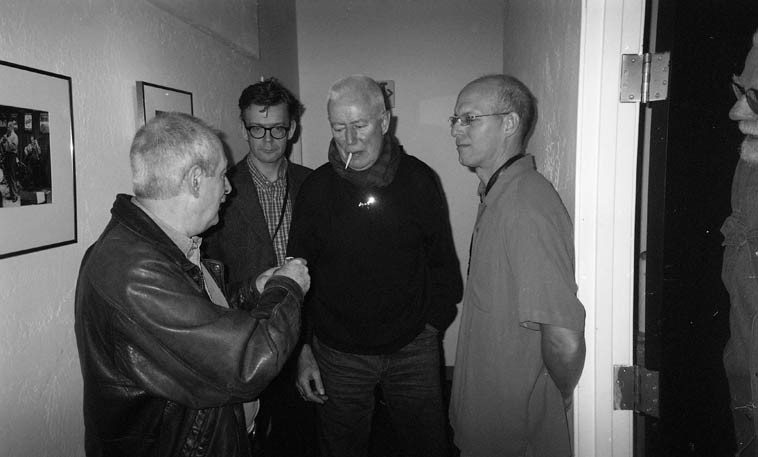 Kenny Davern offers Han a light while Ab Baars and Michael Moore keep watch -- at far right of frame is Tom Albach of Nimbus West Records who knows the band from his late-80s sojourn in Amsterdam -- October 25, 2004 -- photo by Mark Weber ------- Kenny came backstage at intermission to the surprise of the band and exuberantly expressed how much he dug what they were doing and told Han that he knew where he got that habit of rolling up his kick drum pant leg: from Cliff Leeman, which is displayed prominently on the renowned Eddie Condon album JAMMIN' AT CONDON's (Columbia 616) and Han went nuts and admitted it was all true!