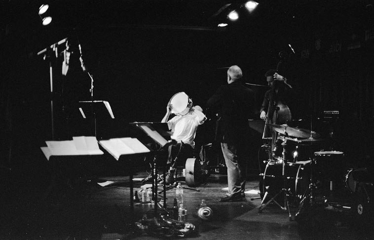 Han Bennink, snare drum; Misha on piano (obscured); Kenny Davern, clarinet; Ernst Glerum, bass -- after the rehearsal all the rest of ICP went to dressing room to eat one of Riha's home-cooked meals while these 4 jammed on an old standard, and I sure wish it had been recorded, whew, it was off the map ---- March 23, 2006 -- photo by Mark Weber -- Note that you see both of KD's ribbon mics: the RCA 44 (1930s) and the RCA 77DX (1940s)