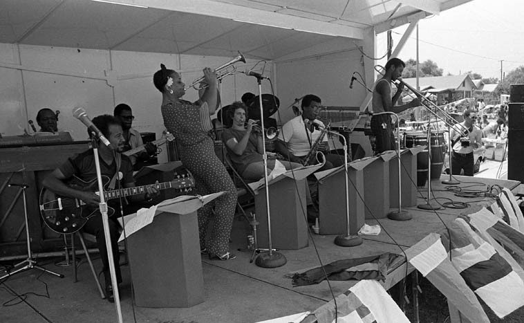 Clora Bryant & Her Swi-Boppers -- Watts Towers Jazz Festival -- July 11, 1981 -- Clora, trumpet; Jeff Clayton, tenor sax; Clarence Johnston, drums; Larry Ball, bass; Cal Green, guitar; Clay Lawrey, trombone, Munyungo, conga; Buddy Gordon, trumpet; Tollie Moore, piano ------ photo by Mark Weber ------ cool thing  about a radio show with Live in-studio guests is that we interleave Live music with recorded music and  we'll be hearing from Clora Bryant keeping things popping
