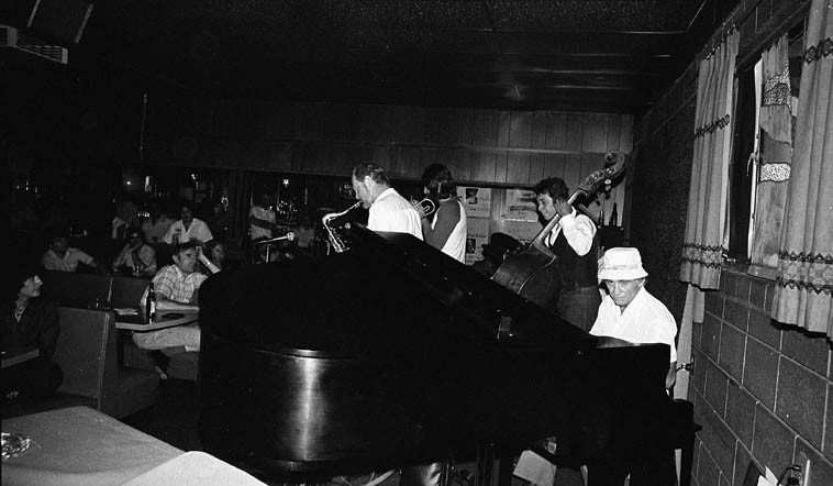 The late Frank Strazzeri with Don Menza Quintet @ Gilberto's, Rt. 66, Cucamonga, California -- June 14, 1981 -- photo by Mark Weber -----  Don, tenor; Chuck Findley, trumpet; Frank DeLaRosa, bass; Dick Berk, drums