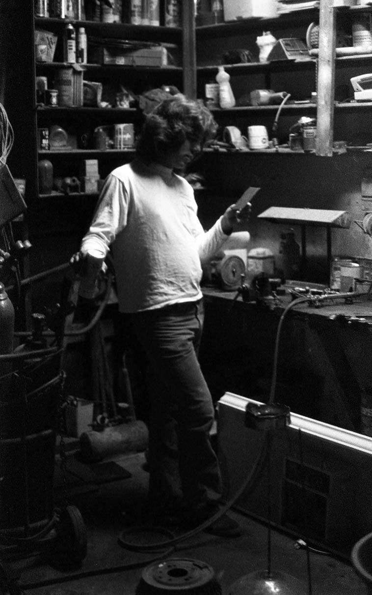 B.Rian in his auto shop ------ Upland, California ---- late 1970s ---- photo by his  brother Mark Weber