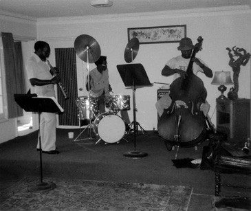 The John Carter Ensemble:  John on soprano saxophone & clarinet; Stanley Carter on bass and electric bass; William Jeffrey, drums ----- June or July 1975 -- photo by Mark Weber ---- directly behind John is the door to the green room