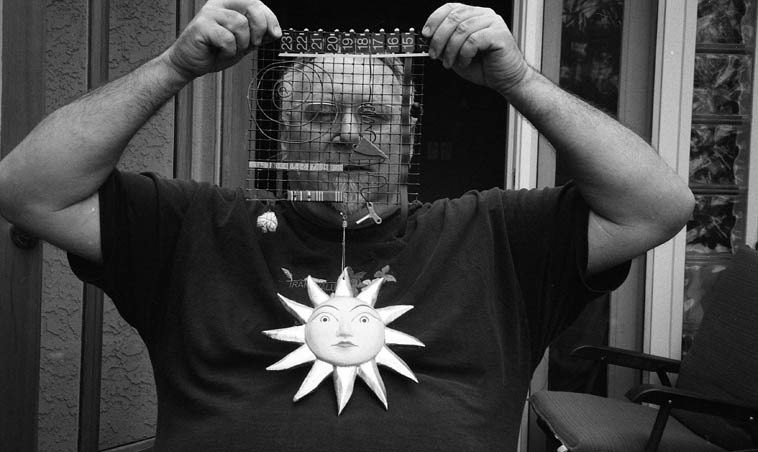 Michael Vlatkovich and an invention of his own making -- April 30, 2o12 Los Angeles -- photo by  Mark Weber -- probability amplitude, nanoscopic orbit entanglements, finite potential amongst the uncertainty principle, co-variants . . . . .