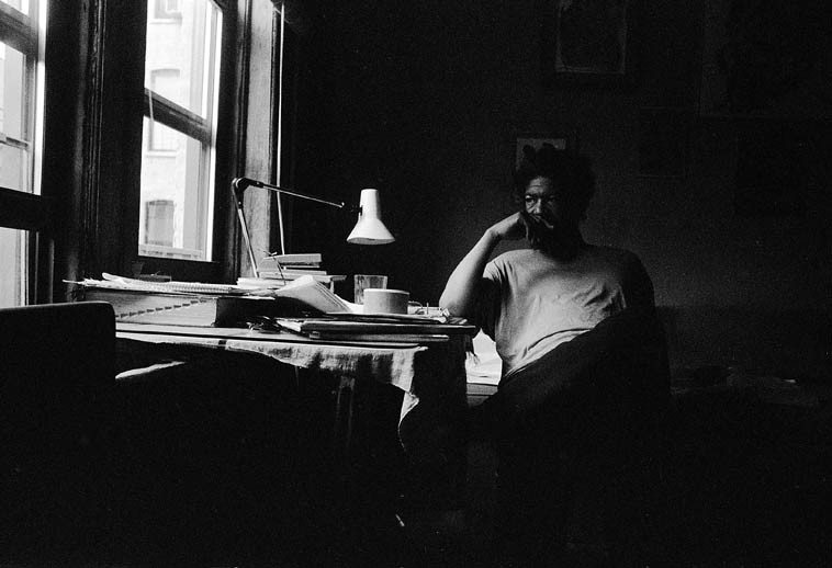 Butch Morris at his desk on the 7th Street, apartment # 5, NYC -- July 1, 1997 -- photo by Mark Weber