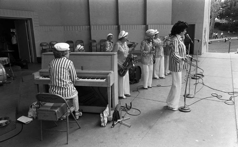 Peggy Gilbert & The Dixie Belles ---- MacArthur Park Bandshell, downtown Los Angeles -- August 22, 1982 ---- Peggy was a major behind the scenes take-care-of-business force at Local 47 for years, she lived to age 102 (d. Feb.12, 2oo7) Please read her entry at Wikipedia ---- I'm looking forward to reading the biography PEGGY GILBERT & HER ALL-GIRL BAND (also a film documentary of same name) ---- possible members in this photo: Marnie Wells, trumpet; Pee Wee Preble, trombone; Natalie Robin, clarinet; Jerrie Thill, drums; Georgia Shilling, piano; Pearl Powers, bass; and Peggy Gilbert on tenor saxophone, (those are the members we'll be listening to from a 1985 recording, minus Pee Wee Preble) -- photo by Mark Weber