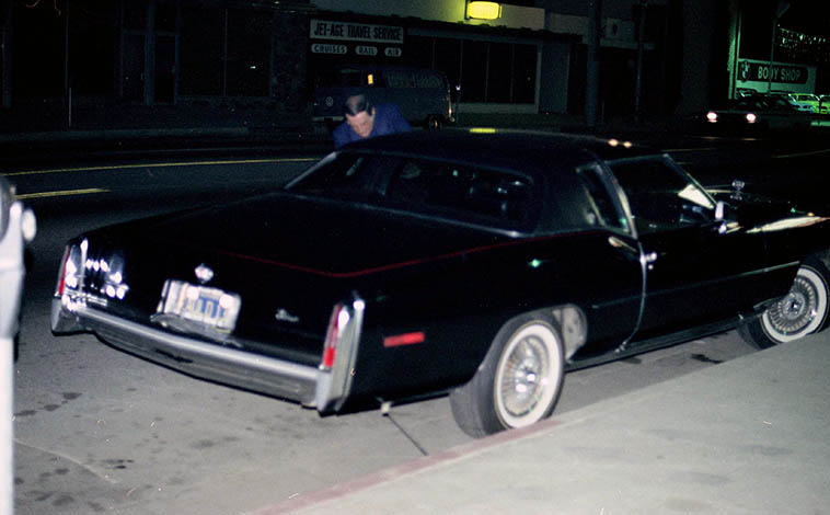 Georgie Auld outside Donte's, North Hollywood ---- note that his Cadillac plates reads AULD 13 ---- (there's a better exposure in existence somewhere, and we're hoping it'll turn up some day, it's probably in the archive at UCLA) (this one is blurry) but, it was a long night at the bar and Georgie's friends were begging him not to drive, alas, he didn't live very far away -- April 27, 1977 -- photo by Mark Weber ----- That's Georgie's tenor all over the soundtrack to Scorsese's NEW YORK, NEW YORK, and Ralph Burns arrangements which I hope to play some on this show, if I don't get bogged down in Christmas music