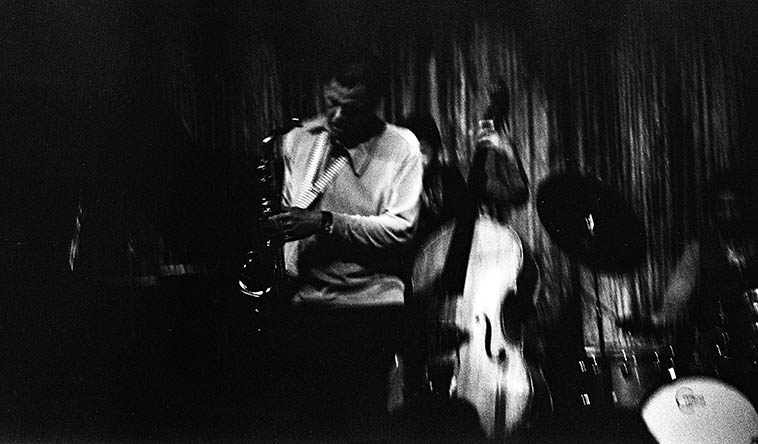 Dexter Gordon at The Lighthouse, Hermosa Beach, California -- December 23, 1976 with a band of Angelenos: Frank DeLaRosa, bass; Jimmie Smith, drums; Dolo Coker, piano -- photo by Mark Weber ---- Dexter would quote Christmas songs in July and we loved him for it, we'd all laugh ---- on-stage in performance was always a laboratory for Dexter, he took everything apart, reassembled it, took wrong turns, got out on a limb, sawed it off, picked himself back up and kept on blowing ---- Ten years ago I gave a box of jazz club memorabilia to UCLA Special Collections -- matchbooks, menus, ticket stubs, buttons, programs, and inadvertently (I discover'd later) had included the roach end of a joint I had smoked with Dexter at some point, that I had encased in a clear plastic box, held in place by a wad of cotton, I kept that for years on the livingroom coffee table as a conversation piece, I sure hope UCLA keeps it safe.