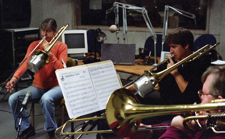 Debra Taylor in KUNM Studio A broadcast of six trombonists playing Michael Vlatkovich's Christmas arrangements -- December 22, 2007 -- I produced this live broadcast with a grant from the station, and asked Debra to act as contractor, she is the Principle Trombonist with New Mexico Symphony Orchestra (at the time of this broadcast, now the band is called New Mexico Philharmonic Orchestra) and she brought in her colleagues from the orchestra -- in this shot: Left to right: Debra Taylor, Dave Tall, Byron Harrington -- photo by Mark Weber