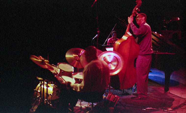 Geri Allen Trio -- Check out Billy Hart's cymbals -- March 20, 2002 -- Taos, New Mexico -- photo by Mark Weber -- That was a fun trip -- I was hired to drive the trio on this tour of Northern New Mexico and Colorado -- Geri on piano -- Robert Hurst, bass -- Billy brought his own cymbals but was at the mercy of whatever drumset was provided, on some of the gigs we cobbled the drumset together from several different kits, and we'd spend the days with Billy riding shotgun talking jazz jazz jazz we really got some history those eight days . . . . .