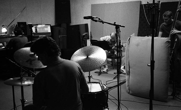Session at KUNM in Studio A -- Dan Dowling, guitar; Cal Haines, drumset; Michael Glynn, bass; Roman Garcia, engineer -- May 22, 2o12 -- photo by Mark Weber