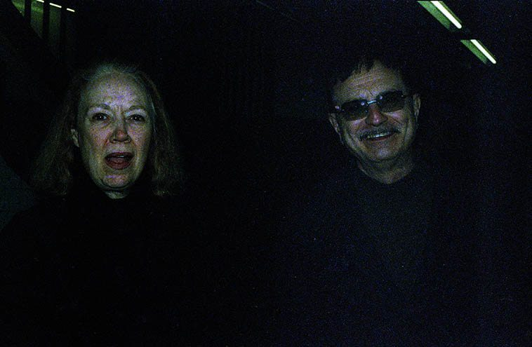 """Connie Crothers & Roger Mancuso -- We're in the NYC subway system going somewhere I forgot where -- December 5, 2004 -- photo by Mark Weber -- I have a notebook entry that says CC could be mercurial, which given the dimensions (one of her favorite words) and interweavings of her life is not hard to believe -- One time on the telephone I was remonstrating over some issue with a poem I was endeavoring to breath life into and beating myself up she said, """"Mark, as long as it's real"""" -- which has been a touchstone for me ever since . . . ."""