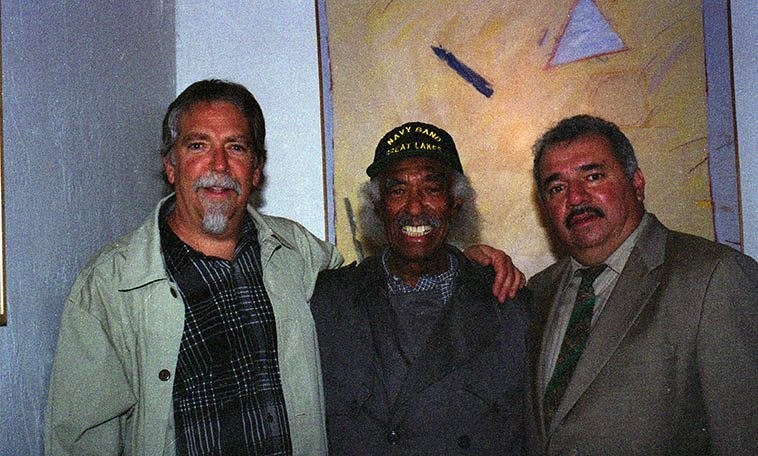 """Mark Weber, Gerald Wilson, Steven Loza -- backstage at the Outpost Performance Space, Albuquerque -- December 4, 2003 ---- I grew up listening to Gerald Wilson's orchestras on the radio in Los Angeles so it was deja vu having him on my radio show that afternoon and this night on stage at the Outpost with a University of New Mexico large jazz band (Steven Loza is a trumpeter and long-time friend of Gerald's and the author of TITO PUENTE AND THE MAKING OF LATIN MUSIC, 1999) -- Gerald brought his wife Josefina to the radio show and I was beside myself as my all-time favorite tone poem of Gerald's is """"Josefina"""" and anyone who lived in Southern California during the 1970s heard that tune everywhere, it is so beautiful, and she was so shy I couldn't get her to say a word during the radio hang"""