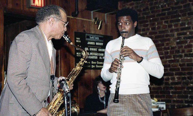 Eddie Chamblee Quartet regular Sunday afternoon gig at Sweet Basil, Greenwich Village NYC -- March 7, 1987 -- photo by Mark Weber -- that's Walter Lee on oboe sitting in (I don't know this musician, an internet search reveals he might be Walter Fulford Lee who took a masters in oboe at Peabody Conservatory, 1978, Baltimore) -- Eddie Chamblee's Quartet this day included: Jimmy Lewis(bass), Kali Madi(drums), Ernest Hayes(piano) ---- Chamblee was in possession of that big tenor sound from Chicago, where the first half of his career was in full swing, making hit R&B records with Sonny Thompson starting in 1947, as well as sessions with T Bone Walker, Lowell Fulson, Memphis Slim, Jimmy Witherspoon, Big Joe Turner, joining Lionel Hampton 1955-1956, then working with Dinah Washington 1958-1959 (was married to her during this time), then in 1960 relocating permanently to NYC -- He was a pure jazzman who was not averse to smoking up a little gutbucket booting, honking, & woofing R&B tenor saxophone for whatever ails you -- the 1980s he was with the Harlem Blues & Jazz Band -- among others, like Count Basie . . . . . Eddie Chamblee (1920-1999)