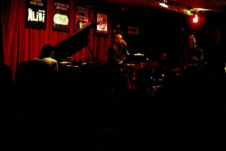 Renee Rosnes Quartet at the old Outpost: Walt Weiskopf (sax), Billy Drummond (drums), Peter Washington (bass), Renee (piano) -- March 24, 1997 -- photo by Mark Weber -- Today we'll listen to Renee Rosnes' deep dive into the elemental forces of life on Earth with her new cd WRITTEN IN THE ROCKS